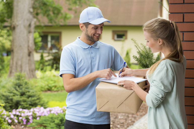 delivery man at customer home woman signing received shipment