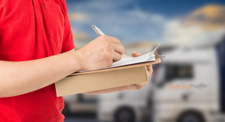 Delivery Driver Signing Parcel Delivered Form