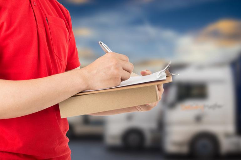 Delivery Driver Signing Parcel Delivered Form