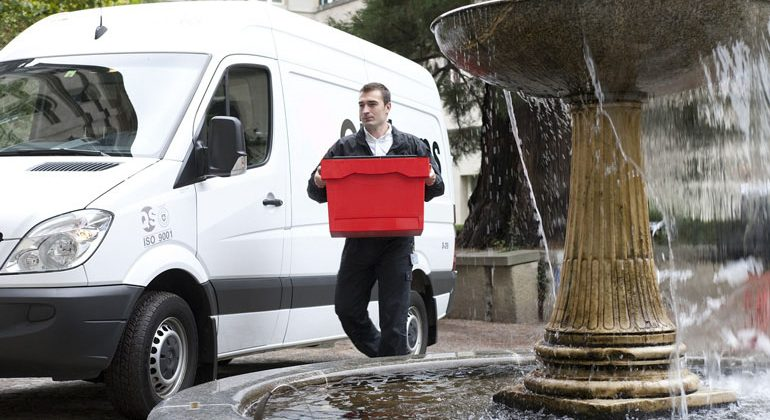 Courier Van and Driver Carrying a Red Box