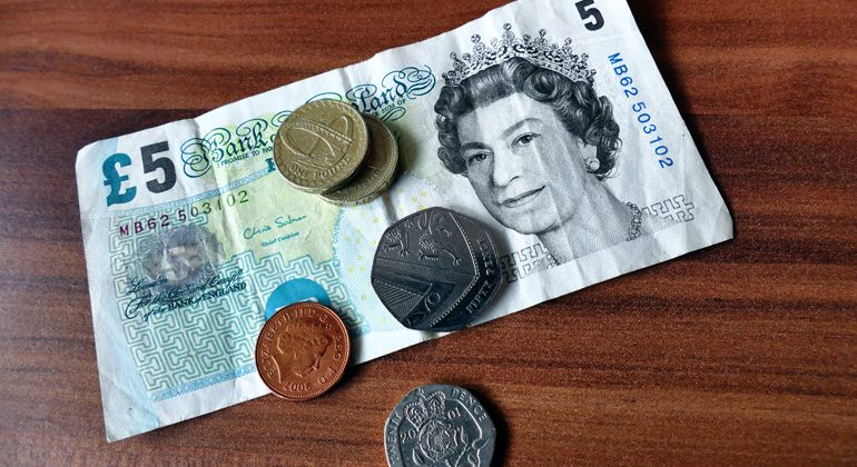 bank notes British pounds and coins