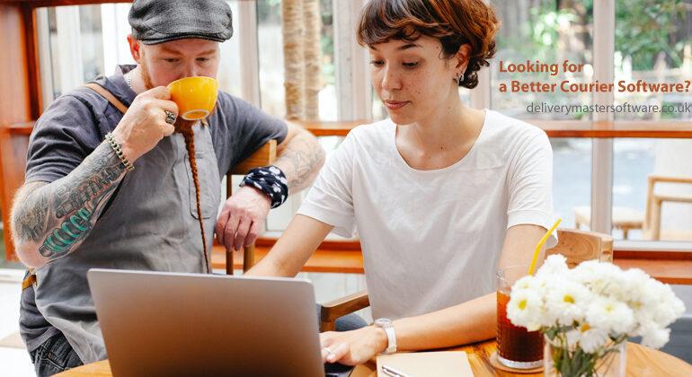 young woman using laptop while British man drinking tea