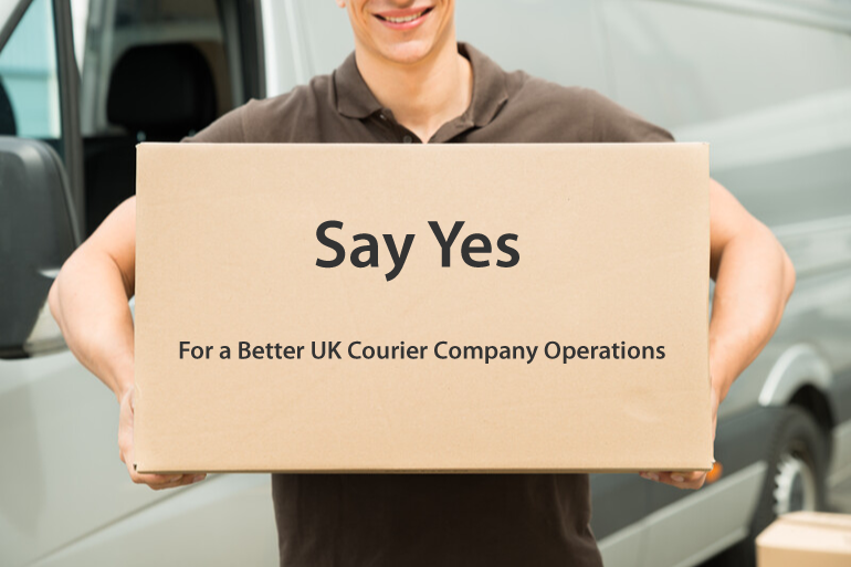delivery man carrying box next to courier van